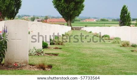 Graves of fallen soldiers in World War I at Tyne Cot cemetery in Passchendaele, Ypres, Flanders, Belgium - stock photo