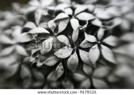 Gravestone with carved flowers and selective focus - stock photo