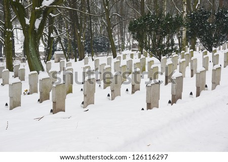 Graveyard on a snowy day in the winter - stock photo