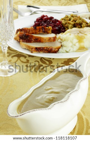 Gravy boat full of turkey gravy. Shallow depth of field. - stock photo