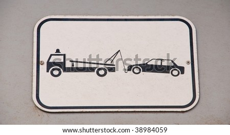 gray and black vehicles towing sign - stock photo