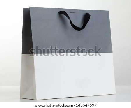 Gray and white shopping bag on white. - stock photo