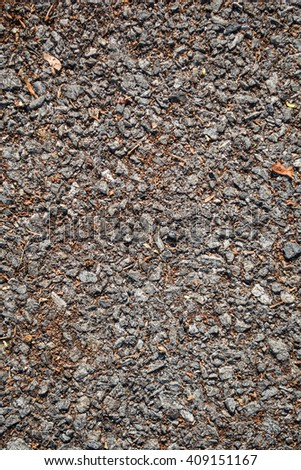 Gray asphalt road texture in sunshine day with some debris. - stock photo