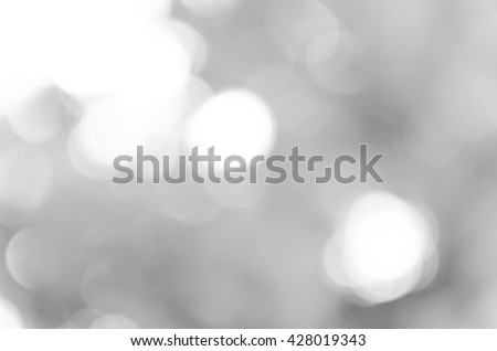 Gray black white bokeh out of focus background from nature forest - stock photo