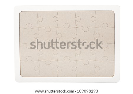 Gray cardboard jigsaw puzzle with white frame isolated on white - stock photo
