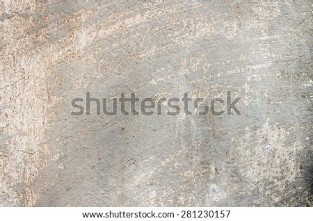 Gray cement wall with traces of the brush on the crumbling plaster and small cracks. textural composition - stock photo