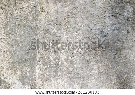 Gray cement wall with traces of the brush on the crumbling plaster. textural composition - stock photo