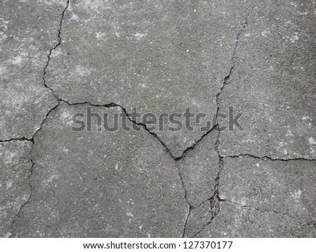 Gray concrete floor with crack - stock photo