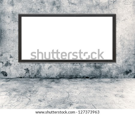 gray concrete wall and plasma tv - stock photo