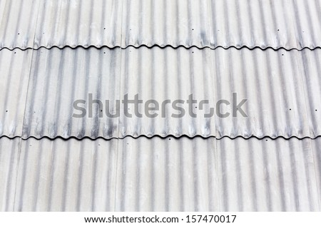 Gray corrugated asbestos roof tiles background - stock photo