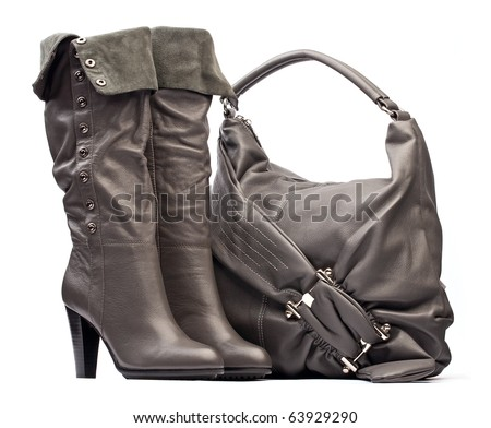 Gray female high-heeled boots and bag on the white background - stock photo