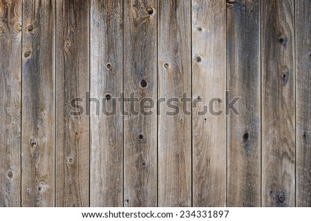Gray finished weathered fence boards with knots  for use as a texture - stock photo