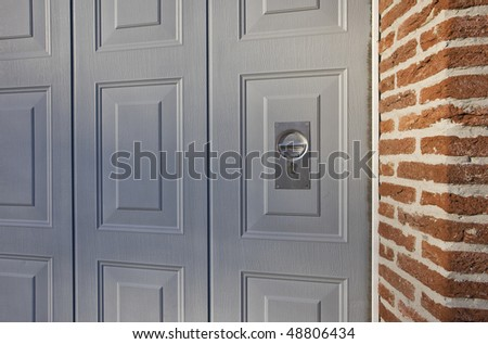 Gray garage entrance door - stock photo