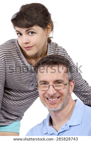 Gray haired father and his teenage daughter on a white background.  The image depicts parenthood or being a single parent. - stock photo