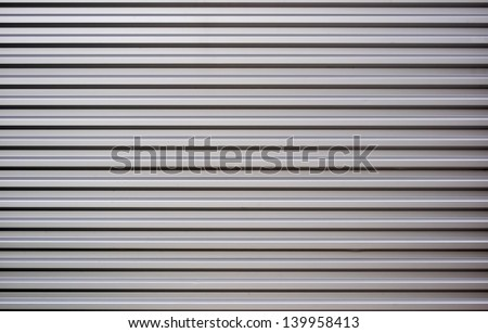 Gray horizontal metal sheet texture wallpaper - stock photo