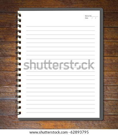 Gray notebook (blank paper) on wood wall. - stock photo