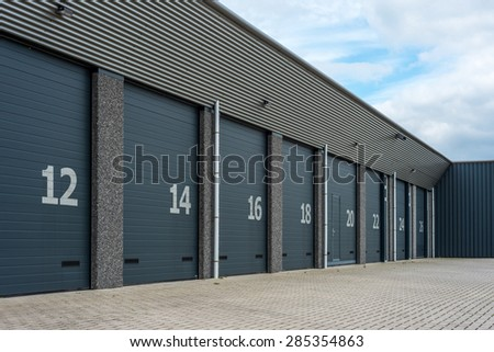 Gray numbered business units or garages - stock photo