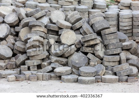 gray octagon concrete brick used to make pathway in construction site - stock photo