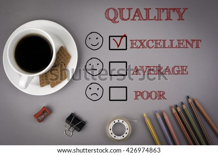 Gray office desk with quality evaluation concept - stock photo