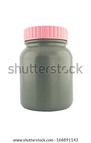 Gray plastic medical container for pills or capsules - stock photo
