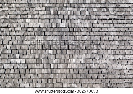 Gray, rectangular, untreated wooden shingles, taken in close-up on a slightly tilted backwards roof in Bavaria, Germany.  - stock photo