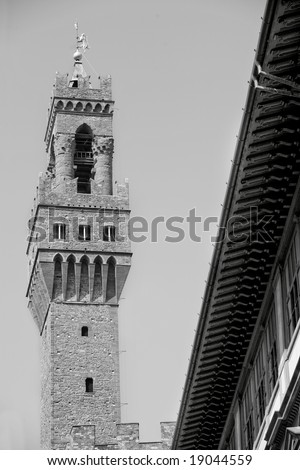 Gray scale photo of the Uffizi Gallery tower in Florence Italy. - stock photo