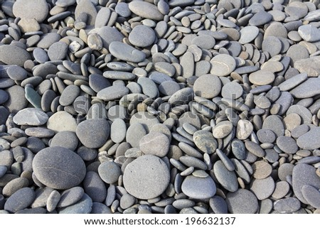 gray sea pebbles texture near the ocean - stock photo