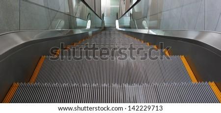 gray steps of escalator - stock photo