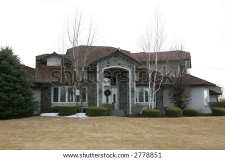 Gray stone house in the winter - stock photo