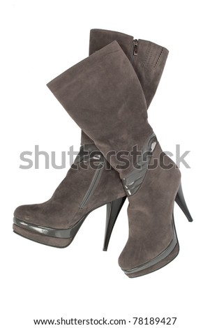 gray suede platform boots and high heels. over white - stock photo