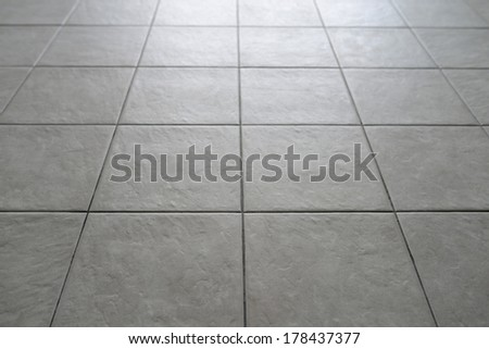 Gray Tiled Floor - stock photo