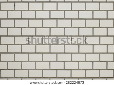 Gray tiled wall background - stock photo