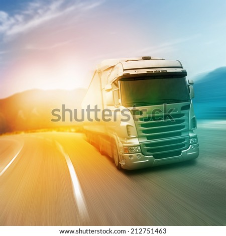 Gray truck on highway - stock photo