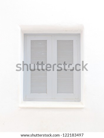 Gray window with white wall of shopping center. - stock photo