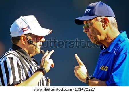 GRAZ, AUSTRIA - APRIL 9 Head coach Rick Rhoades has a discussion with the head referee on April 9, 2011 in Vienna, Austria. The Graz Giants beat the Vienna Vikings 21:14. - stock photo
