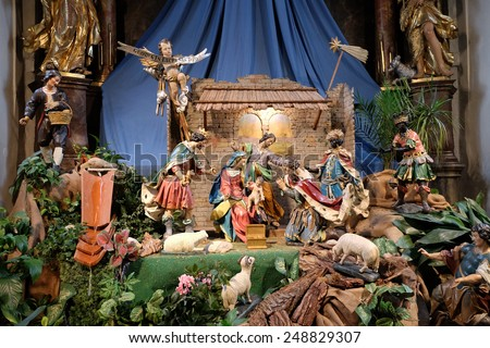 GRAZ, AUSTRIA - JANUARY 10, 2015: Nativity scene, creche, or crib, birth of Jesus in Mariahilf church in Graz, Styria, Austria on January 10, 2015. - stock photo