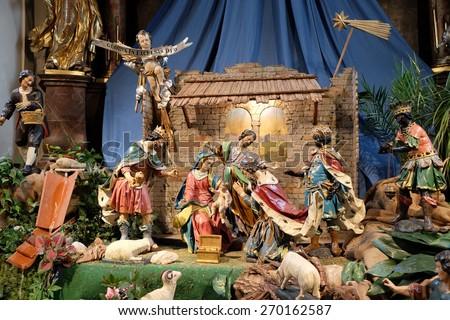 GRAZ, AUSTRIA - JANUARY 10, 2015: Nativity scene, creche, or crib, birth of Jesus in Mariahilf church in Graz, Styria, Austria on January 10, 2015. - stock photo