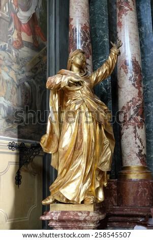 GRAZ, AUSTRIA - JANUARY 10, 2015: Virgin Mary, altar of the Holy Cross, Barmherzigenkirche church in Graz, Styria, Austria on January 10, 2015. - stock photo