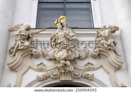 GRAZ, AUSTRIA - JANUARY 10, 2015: Virgin Mary with baby Jesus on the portal of Mariahilf church in Graz, Styria, Austria on January 10, 2015. - stock photo