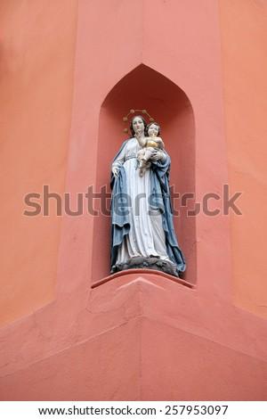 GRAZ, AUSTRIA - JANUARY 10, 2015: Virgin Mary with baby Jesus, statue on the house facade in Graz, Styria, Austria on January 10, 2015. - stock photo