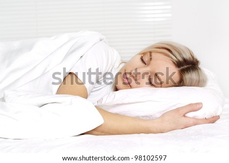 great blonde girl lying on a isolate background - stock photo