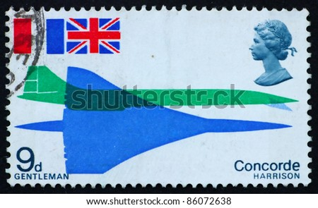 GREAT BRITAIN - CIRCA 1969: a stamp printed in the Great Britain shows Concorde seen from above and from side and flags of France and Great Britain, circa 1969 - stock photo