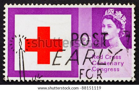 GREAT BRITAIN - CIRCA 1963: a stamp printed in the Great Britain shows Red Cross and Queen Elizabeth II, circa 1963 - stock photo