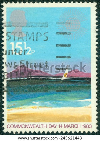 GREAT BRITAIN - CIRCA 1983: Postage stamp printed in Great Britain with image of an artistic seascape painting titled Tropical Island to commemorate Commonwealth Day on 14 March 1983. - stock photo
