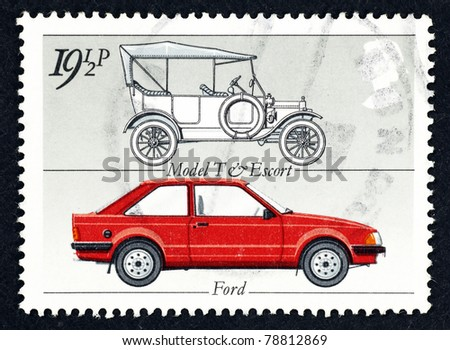 GREAT BRITAIN - CIRCA 1982: Stamp printed in Great Britain showing the ford motor vehicle model T and the model Ford Escort MkIII, circa 1982. - stock photo