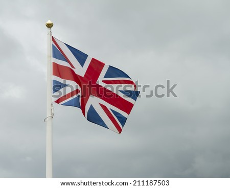 Great britain flag against stormy sky - stock photo