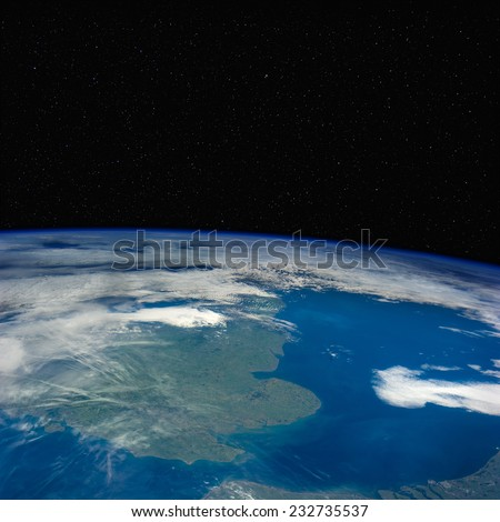 Great Britain from space with stars above. Elements of this image furnished by NASA. - stock photo