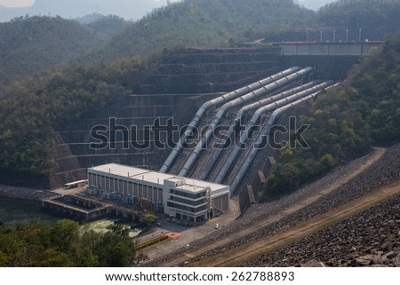 Great dam to generate electricity in the misty valley of Thailand  - stock photo
