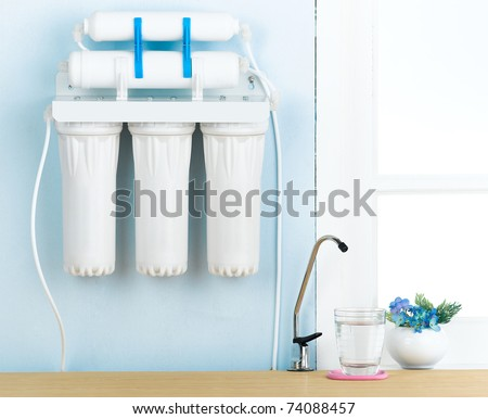 Great filters to purify your drinking water an image isolated in the kitchen interior - stock photo