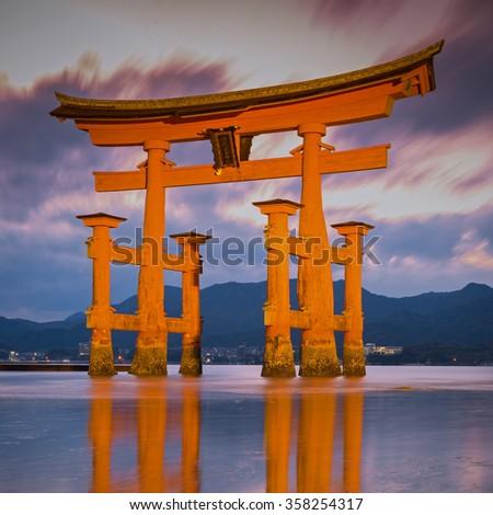 Great floating gate (O-Torii) on Miyajima island near Itsukushima shinto shrine, Japan shortly after the sunset - stock photo
